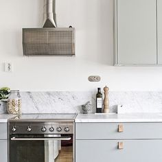 My kitchen | green fronts | marble counter | leather handles | brass tap | smeg stove | alpes inox fan