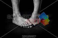 stock photo of dirty barefoot funny crossed male legs