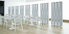 Malva space dividers by Systemtronic Whiskey chairs & Nucleo tables by PUNT