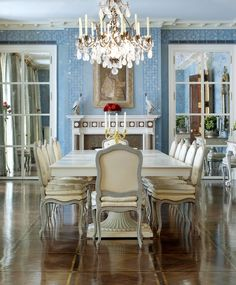 This Markham Roberts dining room reminds me of Versailles with its shiny wood floors and glamorous mirrored walls...