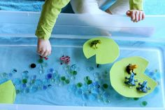 "Frog world - with foam lily pads ("",) Great for a water play table to help with sensory play ! :)"