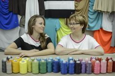 Mom & daughter at family sewing factory