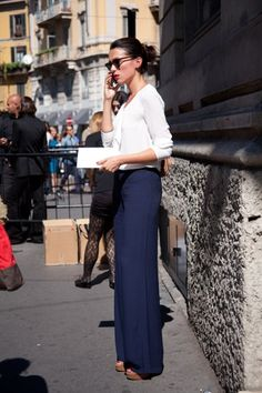 This is how to wear the latest high waisted, wide leg pant - belted at the true waist with a crisp white blouse tucked in and a bold heel. Great for pear shapes.