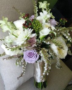 Pretty lavender and white bouquet with a touch of brown hypericum berries.