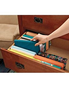 Storing t-shirts is a cinch with this folding system! Solutions.com #Clothes #Storage #Organization