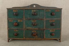 New England painted pine nine-drawer spice cabinet, retaining an old blue and green painted surface, 17.5 H. x 24.25 W.