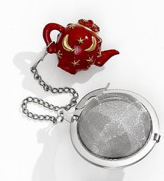 Red Teapot Mesh Ball Infuser  Red Teapot Mesh Ball Infuser  Make a statement with a fancy tea ball infuser. Express yourself with every cup of tea!