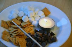 You take mini marshmallows, roast them over tea-light candles, and top them with a single chocolate chip, smooshed between two golden grahams. Fun indoor campout with a tent in the front room! ( smores in the kitchen of course) Mini Candles, Tea Light Candles, Easy Drink Recipes, Dessert Recipes, Golden Grahams Cereal, Good Food, Yummy Food, Fun Food, Healthy Granola Bars