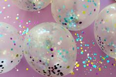 Use a funnel to fill clear balloons with confetti and then inflate.