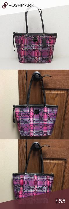 Plaid coach purse Beautiful pink plaid authentic coach purse. Its called the signature c tartan plaid tote. It has some sparkle to it as well. It's very spacious inside. The outside is in great shape, it just has a small black line on the back from a pen, it's hardly noticeable. The inside is a little dirty, but easily cleaned.    🌸NO TRADES🌸 🌸OFFERS ARE WELCOME 🌸 🌸FEEL FREE TO ASK QUESTIONS🌸 🌸 I DO NOT MODEL🌸 Coach Bags Shoulder Bags