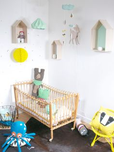 rattan crib and colourful decor