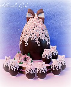 Gorgeous Easter egg cake adorned with a cascade of delicate pink sugar roses. Crafted by proprietor/cake artist Alessandra Frisoni of Alessandra Cake Designer in Porto San Giorgio, Ferma, Italy....