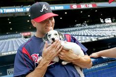 Braves pitcher Tim Hudson hangs out with Turner the Puppy during the team's 2007 Bark in the Park day. AJC File