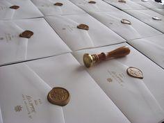 Gold wax sealed invitation