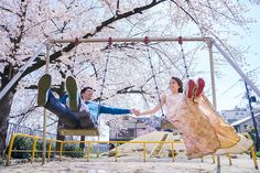 Romantic playtime engagement photoshoot inspiration amidst cherry blossoms // Spring in Kyoto: Claude and Clarabelle's Sakura Engagement