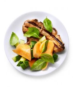 Chopped cantaloupe, cucumber, and lots of fresh basil keep these Vietnamese pork chops light and fresh for the summer.