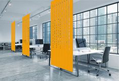 Facade hanging screen made from 100% wool felt. The solid bottom panel section gives additional privacy for desk areas, while the more open design of the top half helps retain the open plan feel of the space...workplace design, acoustics, office design, modern office, acoustic hanging screen