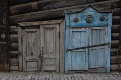 Ancient blue and grey doors.  Just what you expect to see in Siberia.  travel.  doors.  Russia. Europe. Asia. doors of the world.  unique doors.  old doors.