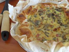 Il tortino di ricotta e carciofi è un piatto ricco e gustoso adatto per uno stuzzichino in compagnia, facile e veloce da preparare
