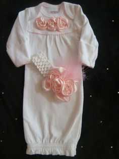Newborn Baby girl outfit - layette - gown - pink rosette ribbon adorn this outift accented with pearls, matching headband. $35.00, via Etsy.