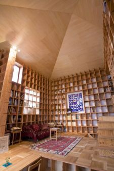 Imagine living in a compact, yet spacious-feeling 557-square-foot home lined with bookshelves capable of displaying 20,000 pounds of books... Amazing design by Kazuya Morita ma shaa Allah.