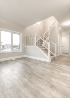 Built by Truman. Cornerstone single family spec home in Calgary, Alberta features hardwood floors, white cabinets, and so much more. By Truman Homes.