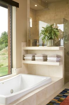Portland bathtub's towel storage. Open marble shelving to store towels at the end of this tub inspired new storage solutions in Houzzers' bathrooms.