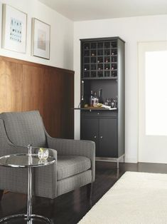 This+compact+bar+unit+with+open+cubbies+for+wine+bottles,+a+fold-down+shelf+for+preparing+drinks,+and+a+drawer+and+cabinet+for+closed+storage+makes+small-space+entertaining+easy.+Photo+courtesy+of+Room+