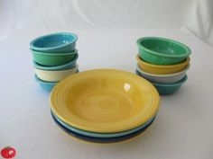 "In the picture on the left are some of my Fiesta fruit bowls that measure 4 3/4 inches across.  They were first produced by the Homer Laughlin China Company in 1935 and ended in 1960.  The fruit bowls on the right measure 5 1/2 inches across and were produced in 1937 through 1959.  They are sometimes referred to as ""oatmeal"" bowls.  In the middle are my Fiesta Deep Plates also known as a soup plate or rimmed soup.  Production began in 1936 and ended in 1969."