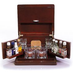 Attractive walnut finished wood mini bar keeps bar essentials in one convenient place. Compact size is ideal for the office, apartment or vacation home.