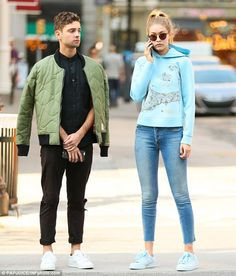 Comfortable customer: Gigi wore a light blue graphic print hoodie, skinny cropped blue jea...