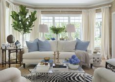Living room Kate Jackson Design leeindustries zebrahide sisal linen figtree white grasscloth wallpaper interior design