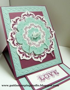 handmade card ... beautiful use of Daydream Medallions and Floral Framelits ... easel card style ... aqua and purple ... great card! ... Stampin' Up!