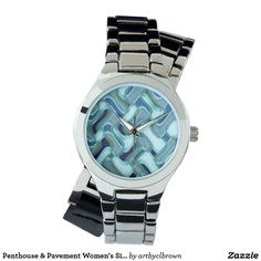 You'll love the way this Women's Wrap-around Watch fits on your wrist. The Penthouse & Pavement Women's Wraparound Silver Watch designed by Artist C.L. Brown features an abstract kinetic light painting edited for design. Own a unique timepiece for yourself! Watch is 3-hand analog Japan Quartz® with a buckle closure and comes with a battery. Watches are water resistant up to 3 ATM and come with a 1 year manufacturer's limited warranty. This product is recommended for ages 13+.