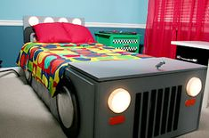 Homemade race car bed.. Easier to make than you think!  Materials:  1. Twin size matteress  2. 3 pre-cut pieces of plywood  3. 4 large plywood discs  4. 4 small plywood discs  5. Toychest  6. Any paint of your choice for the color of the car itself  7. 2 tap lights, 2 bike reflectors!