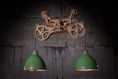 "swoon....  the stuff is picked from trash & curbside, the business is called ""Rustoration"" - love it!  this beauty is called Bubba - Hay Carrier Hanging Lamp"