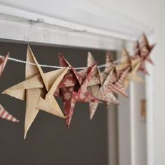Origami Star garland - Christmas Craft week DIY Star Garland Christmas crafts - Girl about townhouse. Love this rustic look!DIY Star Garland Christmas crafts - Girl about townhouse. Love this rustic look! Christmas Makes, Noel Christmas, All Things Christmas, Handmade Christmas, Christmas Ornaments, Christmas Origami, Diy Christmas Bunting, Chritmas Diy, Christmas Cactus