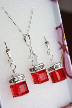 """Red Swarovski Crystal Jewelry Set @ $85 CAD. Get 10% OFF when you use the coupon code """"CHRISTMASTREAT10"""" upon checkout. Valid til Dec. 31, 2014. www.etsy.com/shop/pearltwinkle"""