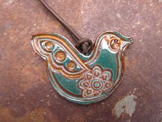 made by my friend Julie  check out her jewelry...pretty  http://www.etsy.com/listing/98012595/emerald-green-ceramic-bird-necklace
