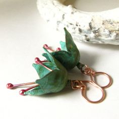 Elegant artisan jewelry, verdigris brass and copper flower earrings are a perfect perennial accent to your wardrobe. Colorful blue green hues