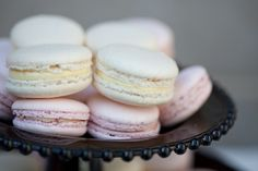pink and white macaroons on black plate. Inspired by Chanel