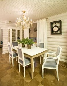 Log walls painted white for a more formal feeling.