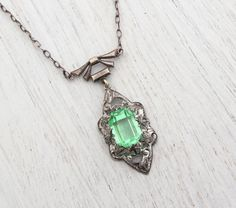 Hey, I found this really awesome Etsy listing at http://www.etsy.com/listing/160885494/antique-art-deco-green-stone-necklace