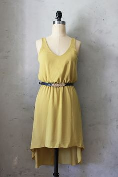 Waterfall Dress in Mustard Yellow with Navy Blue Feather Belt. I love this designer. I ordered my graduation dress from them!