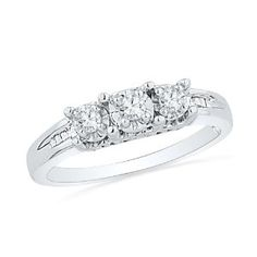 Platinum Plated Sterling Silver Baguette and Round Diamond Three Stone Ring (1/6 cttw) - http://finejewelrygalleria.com/jewelry/wedding-anniversary/platinum-plated-sterling-silver-baguette-and-round-diamond-three-stone-ring-16-cttw-com/