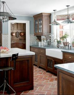 Old Spanish style design kitchen terracotta floor tiles. Houzz.com