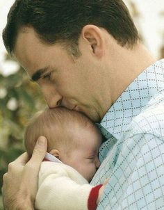 Miss Honoria Glossop: Crown Prince Felipe with his infant daughter Leonor, 2005