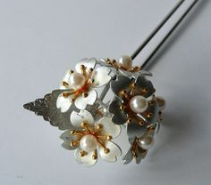 Kanzashi are hair ornaments adorned traditional Japanese hair style. This is a modern vintage bridal kanzashi. Its made from plated alloy and