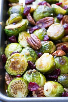 This Maple Balsamic Roasted Brussels Sprouts recipe is an easy side dish for Thanksgiving or any holiday! With lots of garlic, cranberries and pecans!