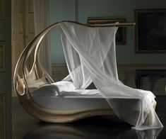 Enignum Wooden Canopy Bed | DudeIWantThat.com    ...YES PLEASE!?!??!?